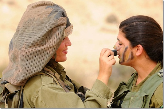 """""""Field Training Week for Ground Forces"""", May 17, 2011.  Weeks of exhausting practice all come down to a single moment- the concluding exercise that will award these female soldiers the title of combat instructors. At the end of the course the female soldiers will be placed in different positions, instructing IDF Ground Forces. Minutes before stepping foot in the simulated battlefield, they make their final preparations."""