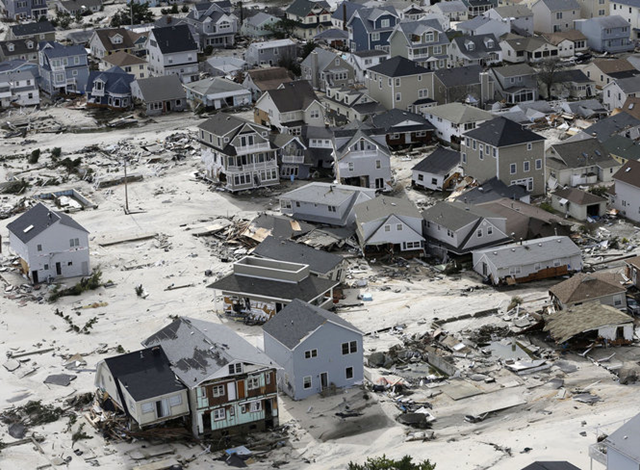 This aerial photo shows the destroyed homes left in the wake of superstorm Sandy on Wednesday, 31 October 2012, in Seaside Heights, New Jersey. New Jersey got the brunt of Sandy, which made landfall in the state and killed six people. A peak of 2.7 million customers were without power. Mike Groll / AP Photo