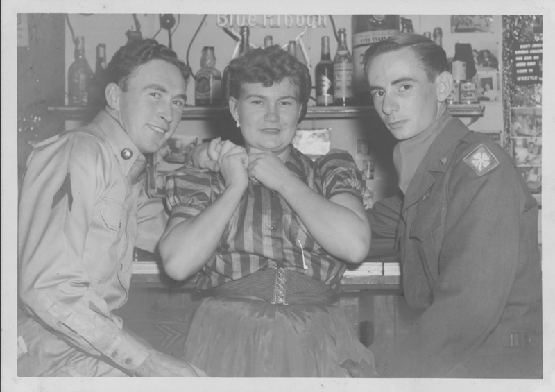 Dirk (left), Gene, and Edgar Sandifer lean against the bar. Circa 1950s.