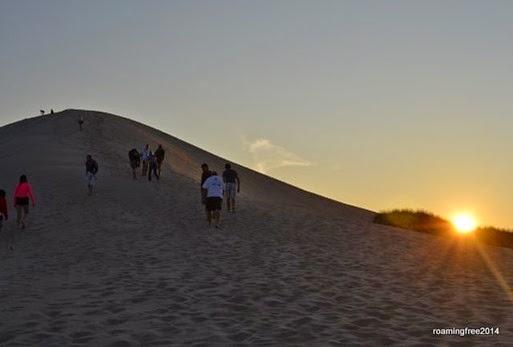 Climbing the dune on the sunset tour