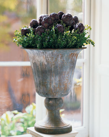 Artichoke Arrangement: This waxen, globed vegetable is more appropriate than you might think for an arrangement, considering the edible head of an artichoke is actually an immature flower. Purple ones with long stems may be specially ordered through a florist.