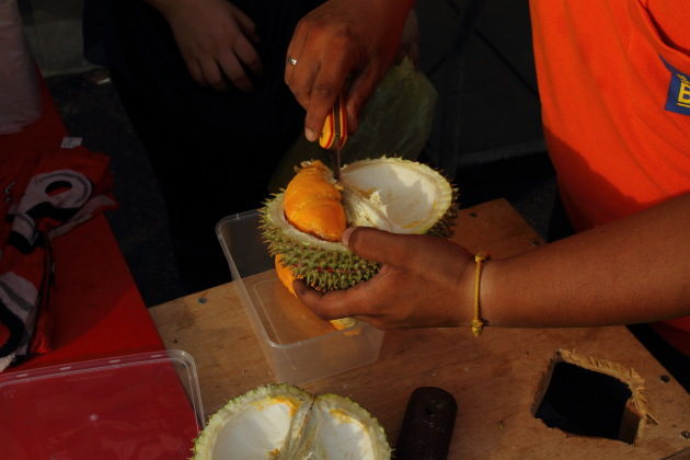 The pungent Durian fruit being cut