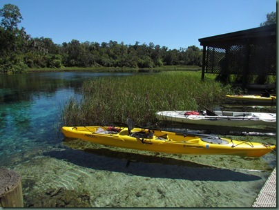 kayaks floating on crystal clear water at headspring