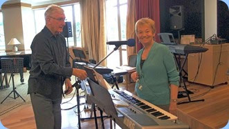 Gordon Sutherland helping to set-up the microphone stand for Diane Lyons who played her lovely Korg Pa900 and with vocals. Photo courtesy of Dennis Lyons