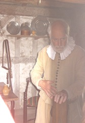 Plimoth Plant older pilgrim man inside house