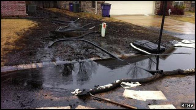 Heavy oil from the Athabasca tar sands mine in Alberta, Canada, flows through a neighborhood in in Mayflower, a small city about 20 miles northwest of Little Rock, Arkansas, after a 22-foot-long section of ExxonMobil's Pegasus pipeline split open on 1 April 2013. Photo: KTHV