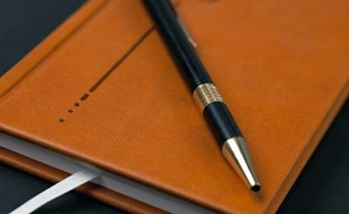 Brown diary and pen