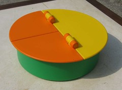 IKEA of Sweden container with a green base and yellow and orange lids