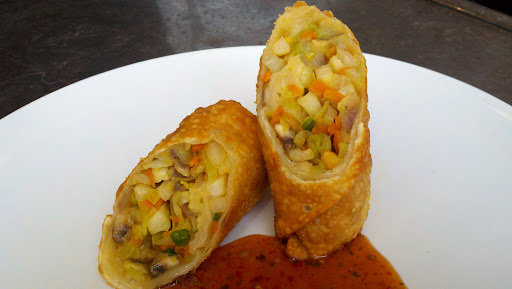Giant Vegetarian Egg Rolls with sweet & spicy sauce | DeLessio's Menu