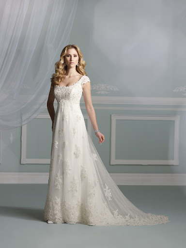 The cap sleeves on this James Clifford gown makes it so sweet!