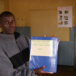 PatrickinKeenYouthMalawiofficewithDCFRNbook.jpg