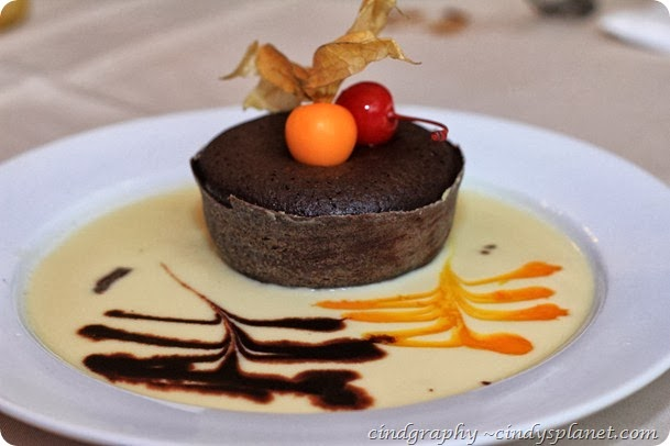 Cava Chocolate Dream Moist Chocolate Cake served in lime custard sauce