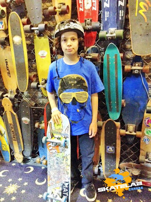 I do not know this little guy or the location where this was taken at but all these boards are old classics and there are 2 of our boards in the pic.