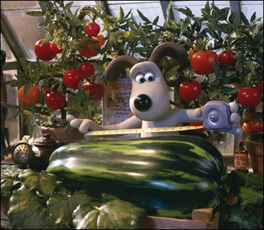 Gromit measures his prize marrow in DreamWorks Animation's clay animation comedy WALLACE & GROMIT, from Aardman.
