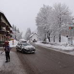 peugeot driving through the street in the snow in Seefeld, Tirol, Austria