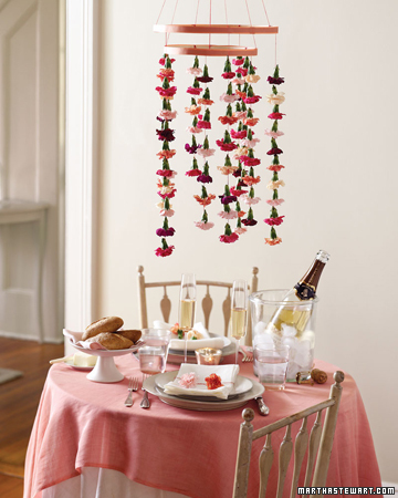 Get creative with the space around your table by adding a hanging carnation mobile. Keep it grounded with matching napkin rings.