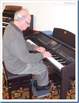 George Watt giving the Club's Yamaha Clavinova CVP-509 a whirl.