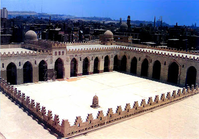 Courtyard of the al-Hakim Mosque in Cairo, 990-1013. The al-Hakim Mosque stood outside the old city wall before al-Jamali had the fortifications renovated.The five-aisled prayer hall has a wide, raised central aisle.The old courtyard, which was allowed to fall into dilapidation and is largely destroyed, was sometimes used as a military barracks in the past, and later as a sports ground. At the beginning of the 20th century it was decided to found the first Museum of Islamic Art in Cairo here. Only in recent years was the mosque completely restored by the Bohras, and resumed its original function.
