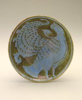 Bowl | Origin:  Probably Kashan,  Iran | Period: late 12th century | Details:  Preoccupation with surface decoration reached new levels of technical sophistication with the use of metal-based &quot;luster&quot; pigmentsa combination of copper and silverin twelfth-century Iran. The pigment was applied to the cold body of an already glazed tile or vessel, which was refired in a specially constructed kiln that allowed the metallic oxides to adhere to the vessel. The result was a shimmering lustrous surface rivaling those of gold and silver metal objects. This small bowl, adorned with a human-headed bird, one of the most frequently depicted mythical creatures in medieval Persian art, is characteristic of this exacting technique. | Type: Stone-paste painted over glaze with luster | Size: H: 7.8  W: 17.3   D: 17.3  cm | Museum Code: S1997.113 | Photograph and description taken from Freer and the Sackler (Smithsonian) Museums.