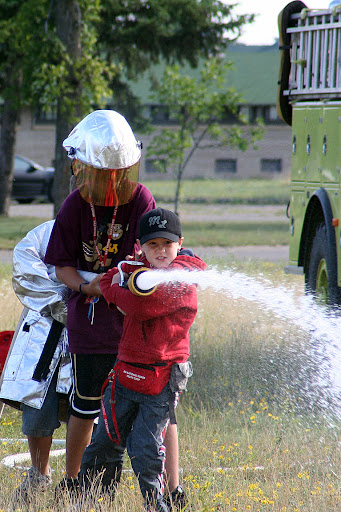 Military Youth Campers run through fire hose drills during the Minnesota National Guard Youth Camp July 31, at Camp Ripley, Minnesota.