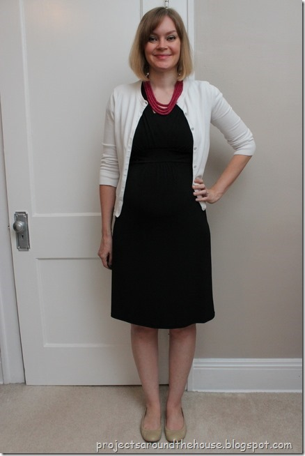 black dress, white cardigan, pink necklace