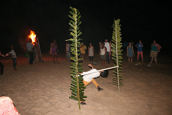 'A bonfire and limbo contest at Coconut Beach in Elmina' Photo by Sandra Vu