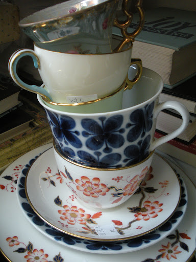 There's something so whimsical about tea-cups stacked this way. I love the mixture of colors and patterns.