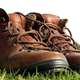 These Boots Were Made For Walkin'! by Chrissie Barrow - Artistic Objects Clothing & Accessories ( laces, walking, grass, brown, leather, closeup, boots, artistic, object )