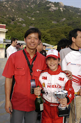 My 1st race and trophy. Standing with my coach Alex Mui