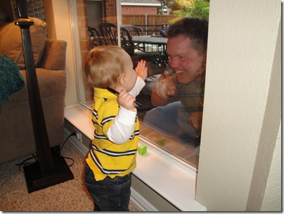 7.  Playing with Daddy through the window