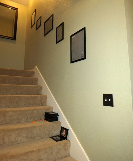 use velcro to hang pictures on stairway 5