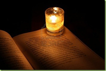 9645192-reading-under-candlelight