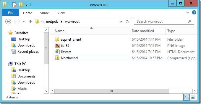 Pasting the zipped web app into the inetpub/wwwroot folder.