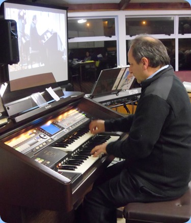 Long time member, Doug Farr, playing our Technics GA3 organ