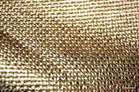 Tkanina meblowa z metalicznym efektem. Złota, miedziana.