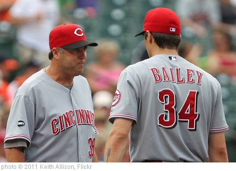 'Cincinnati Reds pitching coach Bryan Price (38) and starting pitcher Homer Bailey (34)' photo (c) 2011, Keith Allison - license: http://creativecommons.org/licenses/by-sa/2.0/