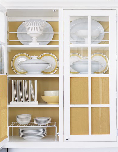 Store and display china with platter guards (top shelf) and dish ledges (middle shelf). Platter guards are created using dowels and curtain fittings. Dish ledges are achieved with quarter round molding fixed to the shelf with wood glue.