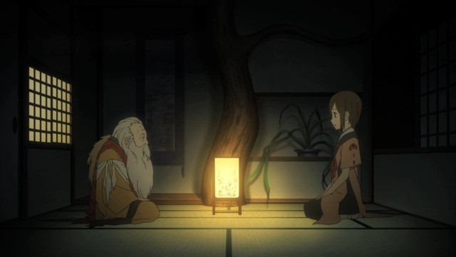 Saki sits respectfully across from an old priest, both in formal priest attire, in a dark room lit only by an ornate lamp between them