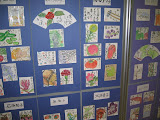 Etegami - hand-drawn postcards - is a popular Japanese  art form. This is a display that was at the Kagoshima City post office.