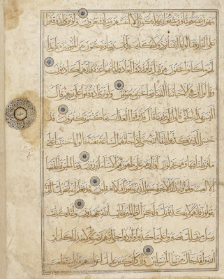 Folio from a Koran, Sura 6, verses 26-35 | Origin:  Iran | Period: early 14th century  Il-Khanid period | Details:  After the eleventh century, a number of more easily transcribed cursive writing styles replaced kufic as the preferred script for the Koran. Among the most popular was the muhaqqaq script, known for its slender verticals and shallow sublinear curves. This folio, from a now-dispersed copy of the Koran, is written in gold muhaqqaq on paper. To further enhance the visual richness of the folio, the vowel marks above and below the letters are indicated in ink made from powdered lapis lazuli, a semi-precious stone. Verse endings appear as gold and lapis lazuli spheres, while the larger medallion in the margin marks an additional text division. Sumptuous yet restrained, the folio is characteristic of Korans produced under the Mongol Il-Khanid dynasty, which ruled over Iran and Iraq from 1256 to 1353. | Type: Ink, opaque watercolor and gold on paper | Size: H: 43.5  W: 34.5  cm | Museum Code: F1942.4 | Photograph and description taken from Freer and the Sackler (Smithsonian) Museums.