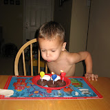 Blowing out his breakfast candles 11-3-11 (3).JPG