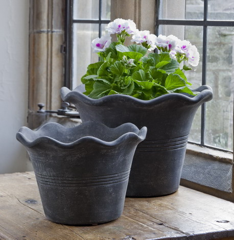 The wavy edges on these pots create a whimsical, feminine effect. (campaniainternational.com)