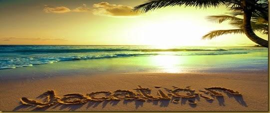 Art Summer vacation concept--vacation text on a sandy ocean beach
