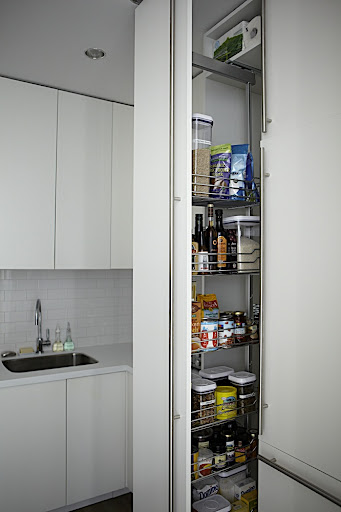 A pull out pantry holds all of my staples.  It's fully stocked with everything I need thanks to Martha.