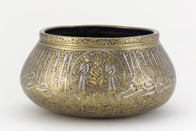Bowl | Origin:  Iran | Period: mid 14th century | Details:  Not Available | Type: Brass, inlaid with silver, gold and a black organic material | Size: H: 12.0  W: 23.0   D: 23.0  cm | Museum Code: F1980.25 | Photograph and description taken from Freer and the Sackler (Smithsonian) Museums.