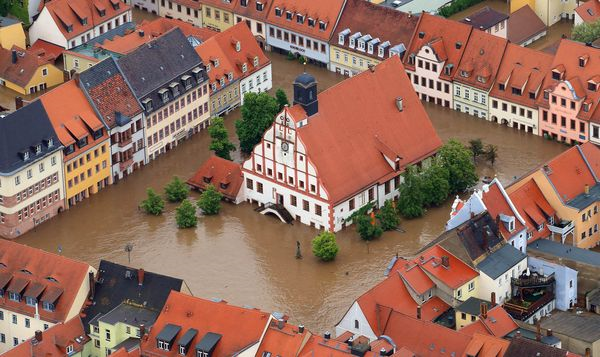 Following days of heavy rainfall in central Europe, the town hall in Grimma, Germany, was turned into a virtual island as water from the River Mulde flooded the town center, 6 June 2013. Photo: Jens Wolf / European Pressphoto Agency