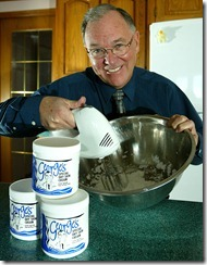 Calgary, Alta.---8 Jan.2004--At his home in NW Calgary, George Doherty (co-inventor Georges Hand Cream) with samples of the cream and a set-up with cake mixer and cream in bowl, the way he started making it.   digital photo by Larry MacDougal and story by Susan Scott