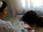 Here Marisa and Corinne are crafting some sequins on to a place card.