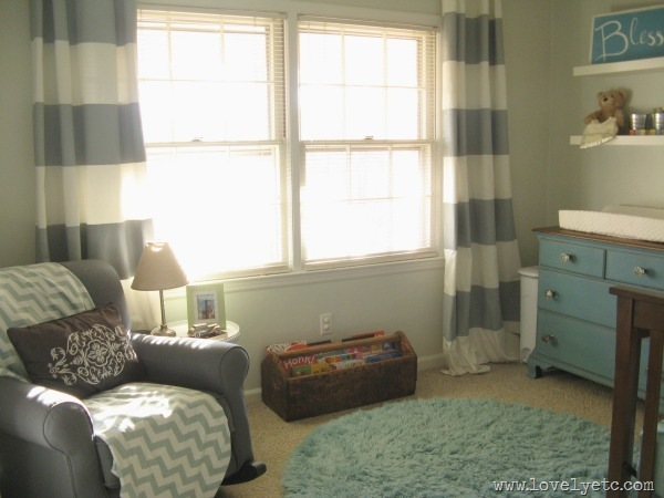 nursery with striped curtains