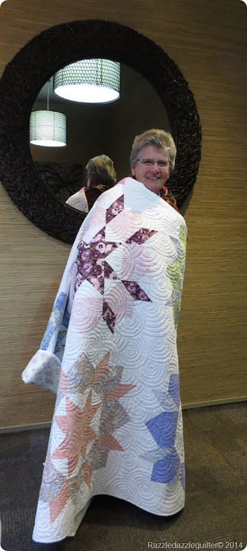 Andreena draped with Swoon quilt 1